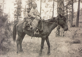 Kalispel woman and child on horseback, ca. 1910. Flathead Reservation, Montana. Photograph by Henry Fair. (P4166)