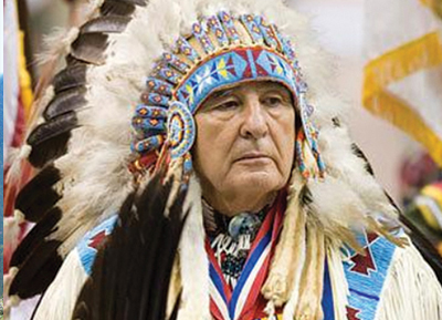 Native American in a headdress and traditional attire