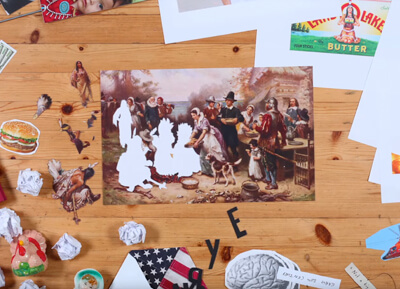 desk top with thanksgiving image in the center with thanksgiving-related items surrounding the image
