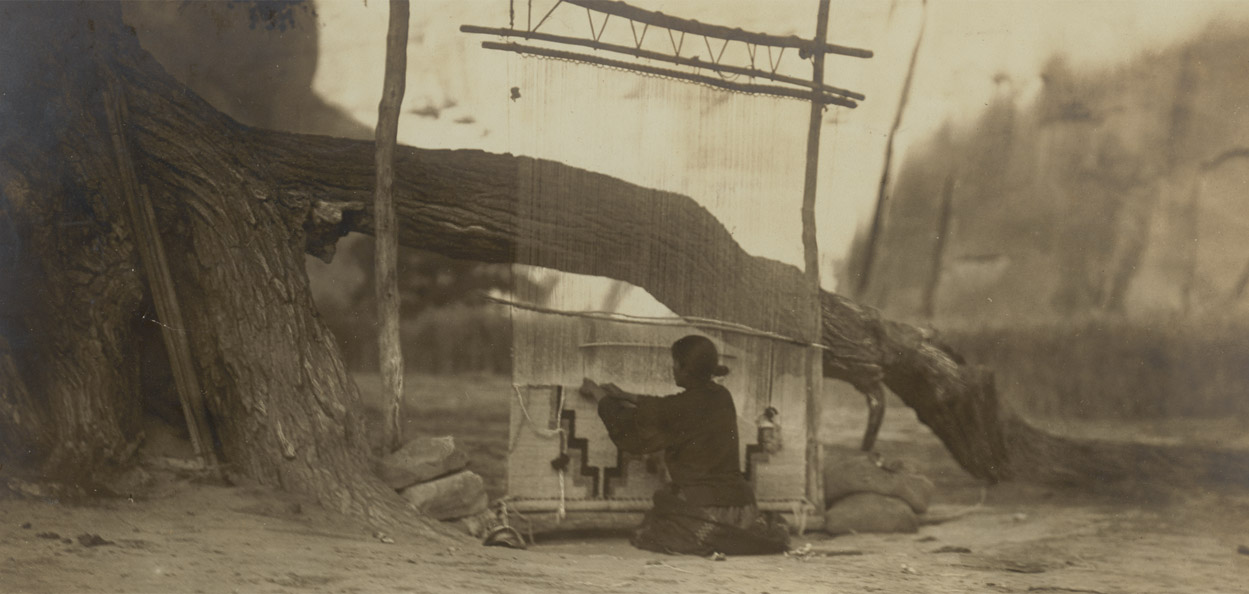 The Blanket Weaver, 1905. Navajo (Diné), Arizona or New Mexico. Photograph by Edward S. Curtis, National Anthropological Archives, Smithsonian Institution, Image 04607