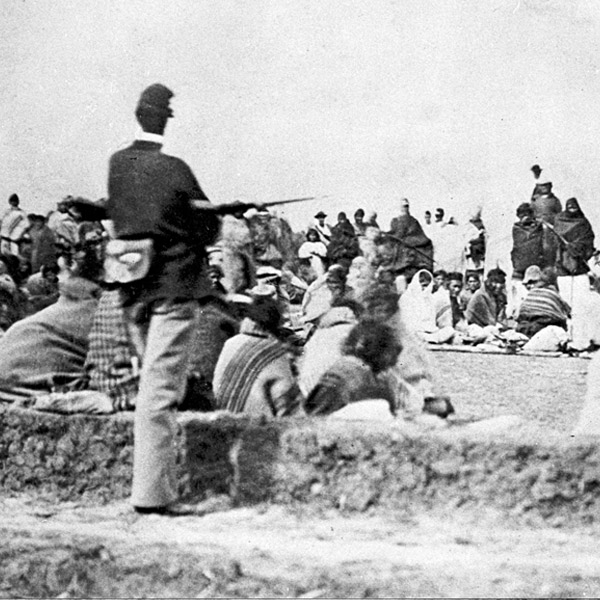 Navajo Indian captives under guard, Fort Sumner, New Mexico, ca. 1864–1868. Photograph by the United States Army Signal Corps, courtesy of Palace of the Governors Photo Archives (NMHM/DCA), 028534