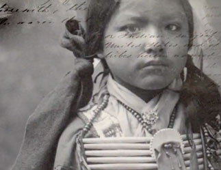 young Native American girl in black & white historical photograph