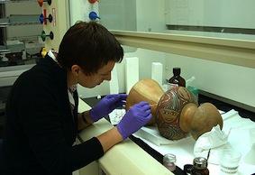 Alison Madsen conserving Nazca ceramic drum
