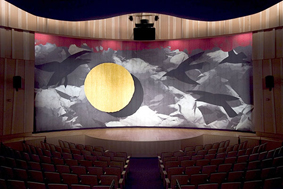 The Rasmuson Theater's handwoven curtain depicts Raven and the Moon