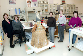 Emily Kaplan, Kelly McHugh, Shelly Uhlir, Susan Heald, Marian Kaminitz, in Conservation Lab with Tucano mask outfits
