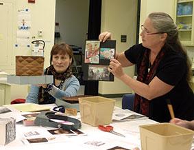 Luba Nurse assists Tlingit Weaver Teri Rofkar