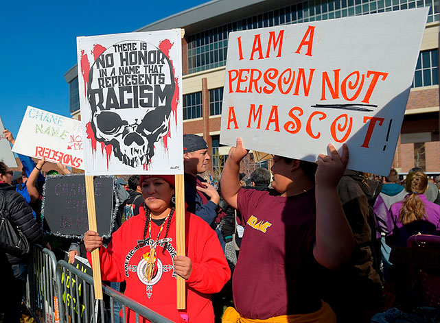Image of Native Americans and supporters protest the Washington Redskins