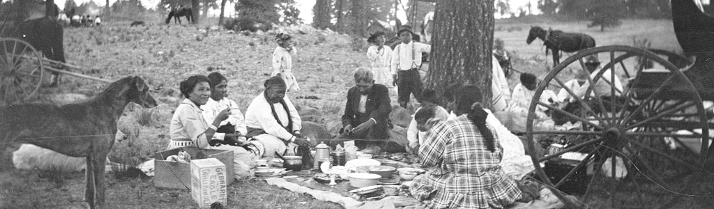 Men, women, and children at a picnic, Mescalero Apache Reservation