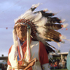 Joseph Medicine Crow, about to enter the dance arena at Crow Fair, holds a dance stick representing the horses he captured from German SS officers in World War II. Photo by Glen Swanson.
