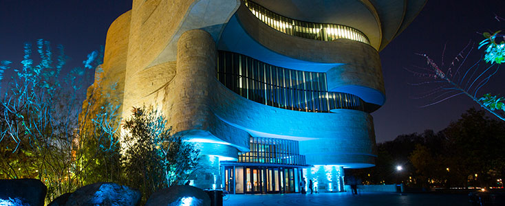 Nighttime view of the NMAI-DC building